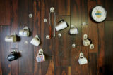BG0856 Coffee cups hang on the wall at T.J.'s Tires near the Time Zone line that divides the...