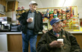 BG0929 Lawrence Mayer, left, and Marion Crumrine, left, enjoy a cup of coffee at the Frontier...