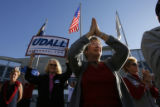 DM3229  Paula Szilard, front center, of Littleton claps for Senatorial candidate Mark Udall as he...