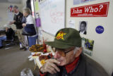 80 year-old Raymond Barrett (cq) takes a break from volunteering on the Schaffer team as...