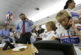 Republican U.S. senate candidate Bob Schaffer (cq) talks to a supporter at his headquarters in...