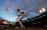 Matt Holliday prepares for his at-bat before the start of the Colorado Rockies against the St....