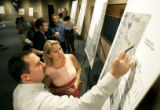 Mark Shotkoski (cq, left) of Littleton points out a few details on a map to Keri Davis (cq,...