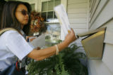 etter carrier Ya Lin delivers a new batch of mail-in ballots in Denver on Tuesday, October 28,...