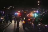 Police surround an apartment building in the 3500 block of South Kendal St, Tuesday evening,...