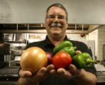 Al Henry (cq), holds some of the makings that he uses in his winning salsa, Wednesday afternoon,...
