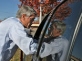 Mark Udall, running for U S Senate, talks to Claudia Arce, while she waits to pick up her kids...