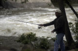 Jarrod Witzke (cq) ,34, fishes for trout in Boulder Creek on Wednesday May 25, 2005 in Boulder,...