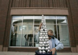 (279) Jesse Baiotto installs Christmas decorations for the holiday shopping season at Belmar...
