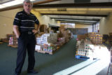 Volunter Chris Michalik (cq) stands in  the Arvada Community Food Bank on Thursday October...