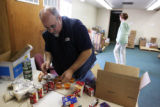 Volunteer Bill Scharfenberg (cq)  sorts out canned goods and rice at the Arvada Community Food...
