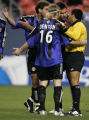 Colorado Rapids players argue with a referee during the first half of the game against the San...