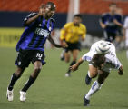 Colorado Rapids #10 Jean Philippe Peguero chaces  San Jose Earthquakes #2 Eddie Robinson as he...