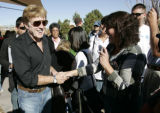 Actor producer Robert Redford shakes hands with Mark Udall supporters  at a Udall rally at the...