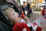 Eila Spilde ,2 makes the perfect treat as she eats 3 lollipops together while Trick-or-Treating...