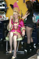 Heather Koski, dressed as Marie Antoinette,gets her hair done at the Zing Salon by Salina Andazola...