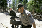 Rocky Mountain National Park Rangers George Weaklim (cq, left) and Larry Morgan (cq, right) move a...