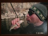 Jon Stiles (cq) acts as if he will kiss a fish while on a fishing trip.  Jon Stiles  was killed by...