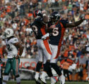 (CS0393) Eddie Royal and Brandon Marshall celebrate after Royal caught a touchdown pass while...