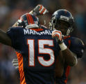 Denver Broncos Eddie Royal after first quarter touchdown with Brandon Marshall against Miami...