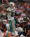 (CS1096) Greg Camarillo catches a pass over Karl Paymah in the fourth quarter of the Denver...