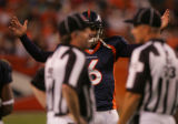 (CS1438) Jay Cutler appeals to the refs after a penalty for al illegal block in the back in the...