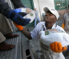 Charles Monroe (cq), helps bring in turkeys, Monday morning, November 17, 2008, Denver Rescue...