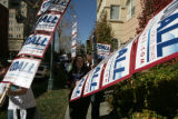 Kaitlyn O'Hara's (cq) campaign sign hits a tree as she walks back with Jennifer Sisk (cq) (L-R)...