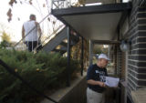 (170) An Obama campaign volunteer James Engelking, an attorney from Golden, talks with registered...