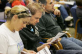 Amanda and Stuart Miller, left, of Denver, fill out requests for replacement ballots at the Denver...