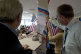 Volunteer Phil Kelly (cq) flips a page to view that tomorrow is election day. Supporters for...