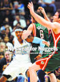 0161 Denver Nuggets forward Carmelo Anthony #15 holds his ground against Milwaukee Bucks center...
