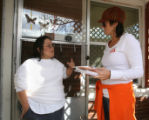 Missy Holoubek (cq), of Latina Initiative, talks to resident Denise Cabral (cq) in the 700 block...