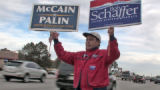 CODER113 - Gus Hoyer (cq) holds up a sign supporting McCain/Palin and a Schaffer sign for congress...
