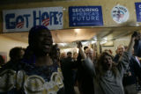 Opalunga Pugh, left, recites a poem during the Obama victory party at Brother Jeff's Cultural...