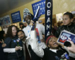 Wynita Mills, right, sobs moments after Obama was declared the winner of the presidential...