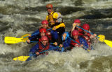 Billy Mattison guides a raft through the Dowd Chutes on the Eagle River Wednesday afternoon June...