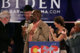 Colorado Senate President Peter Groff clenches his fists in support along with other state...