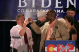 Colorado Senate President Peter Groff bumps fist with State Senator Chris Romer, D-Denver, left,...