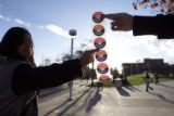 (062) Volunteers for the Students for Obama hand out stickers in support of Barack Obama on the...