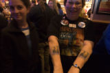 (258) Dottie Rawsky, 62, of Broomfield, shows off her Obama tattoos at an event organized by the...