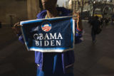 (327) Although he's already voted, Adonis Alexander, 21, of Denver, shows off his support for the...