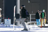(154)  A skier rests at the bottom on opening day at Winter Park Resort in Winter Park, Colo., on...