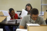 Election officials revise provisional ballots at the Denver Elections Commission a day after the...