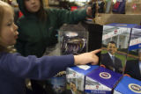 (141) Rio Trevathan, 4, of Chapel Hill, N.C., correctly identifies an Obama figurine  while his...