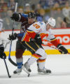 DM0331  Colorado Avalanche center Tyler Arnason #39 battles Calgary Flames left wing Curtis...