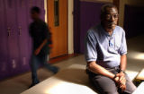 (Far Rt.) Student Advisor Adolph Plummer, 67, sits in one of the halls he patrolled during his...