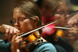 MJM646  Danica Smith (cq) performs violin during the Lamont Women's Choir concert rehearsal...