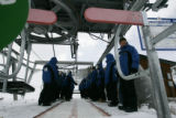 Breckenridge Ski Op workers train at catching riders having problems getting on the chair lift on...