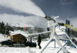 Ski maintenance manager  Brett Gray adjusts snow guns on at the base of Peak 8 at Breckenridge,...